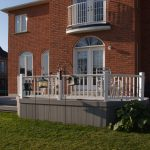custom built deck with white railings