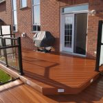 composite deck with black rails and glass panels