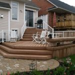 custom built low multi level deck with white railings